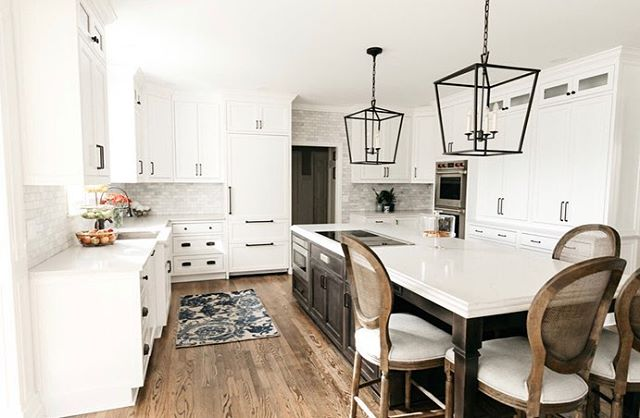 Another day, another white kitchen. Classic white kitchens never get old. We switched this one up with an espresso distressed island for contrast and interest. The bronze perimeter hardware ties everything together!  What cabinet color are you gravitating towards these days?