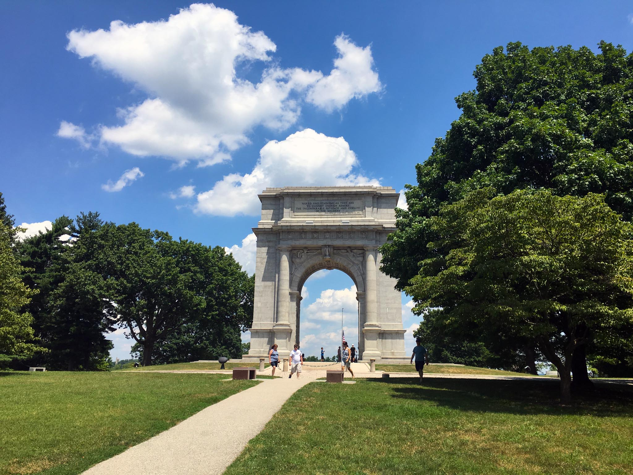 Designed by Paul Phillipe Cret, the National Memorial Arch is inspired by the Arch of Titus (A.D. 81) in Rome. It was dedicated on June 19, 1917, and commemorates the arrival of Washington and the Continental Army to Valley Forge. It was unveiled for a second time in August of 1997, after restoration was made possible by funds from the Free and Accepted Masons of Pennsylvania.