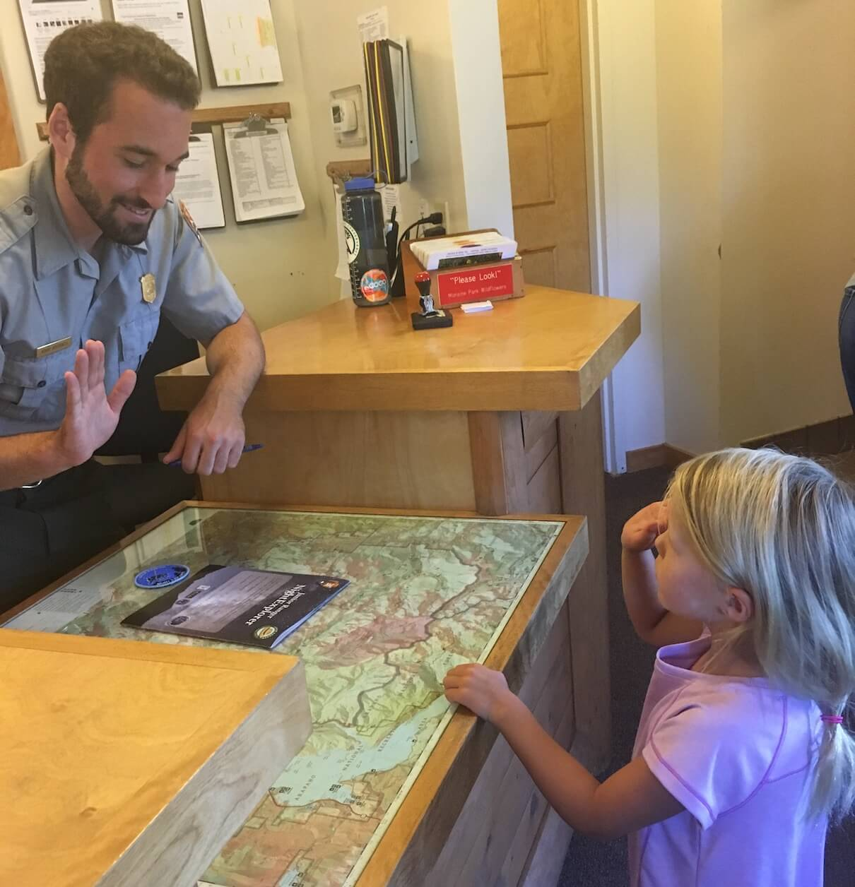 The author's daughter, getting her Night Explorer Jr. Ranger patch. Photo by Courtney Johnson.