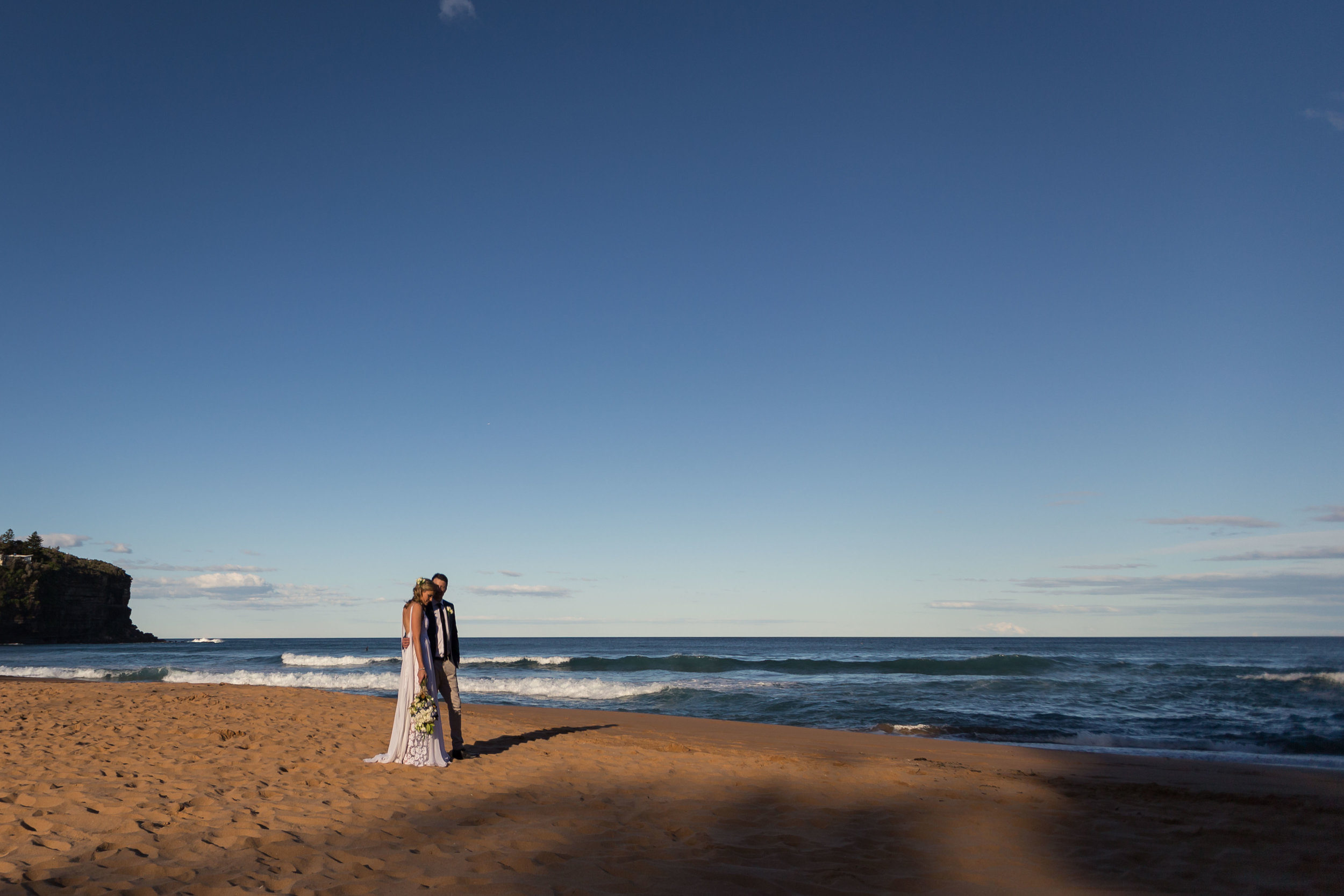Bride and groom on the beach. Bilgola Beach wedding.