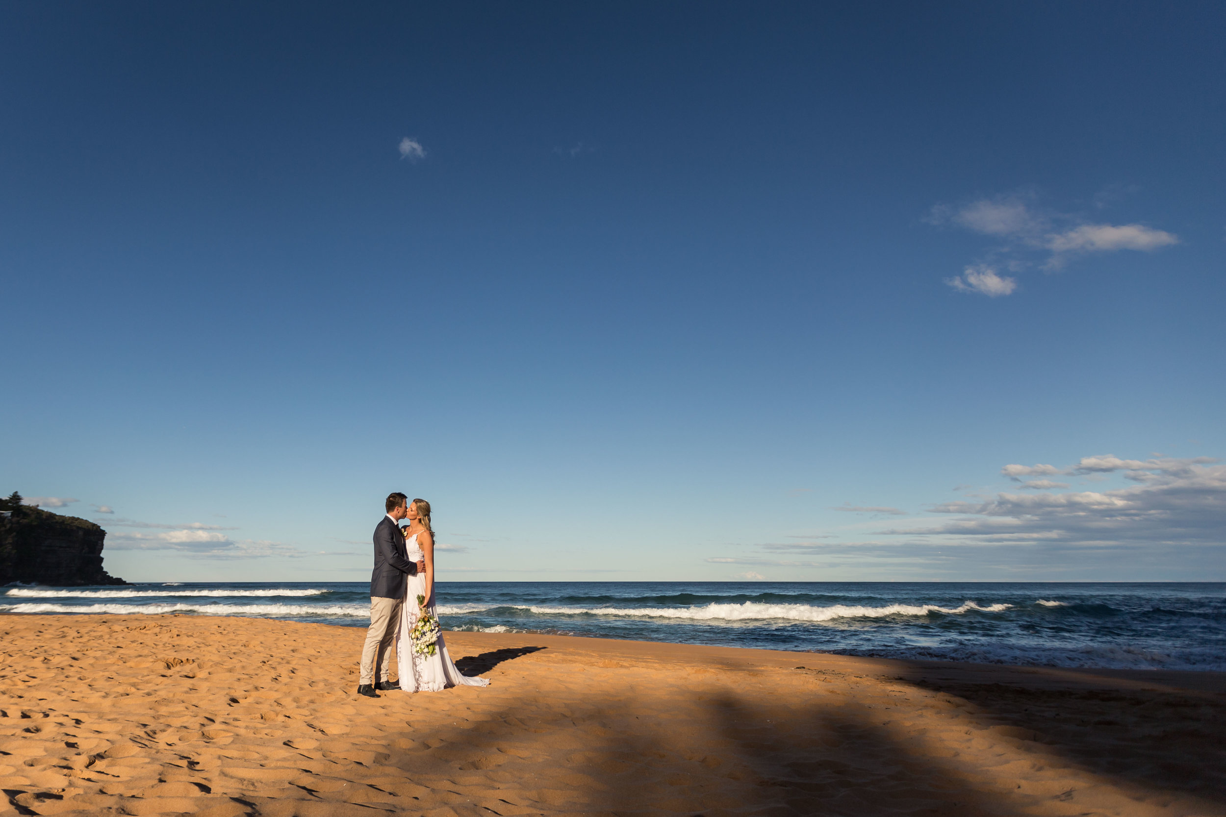 Bilgola Beach Wedding. Bride and Groom photo on Beach. Relaxed, natural wedding photography Sydney.