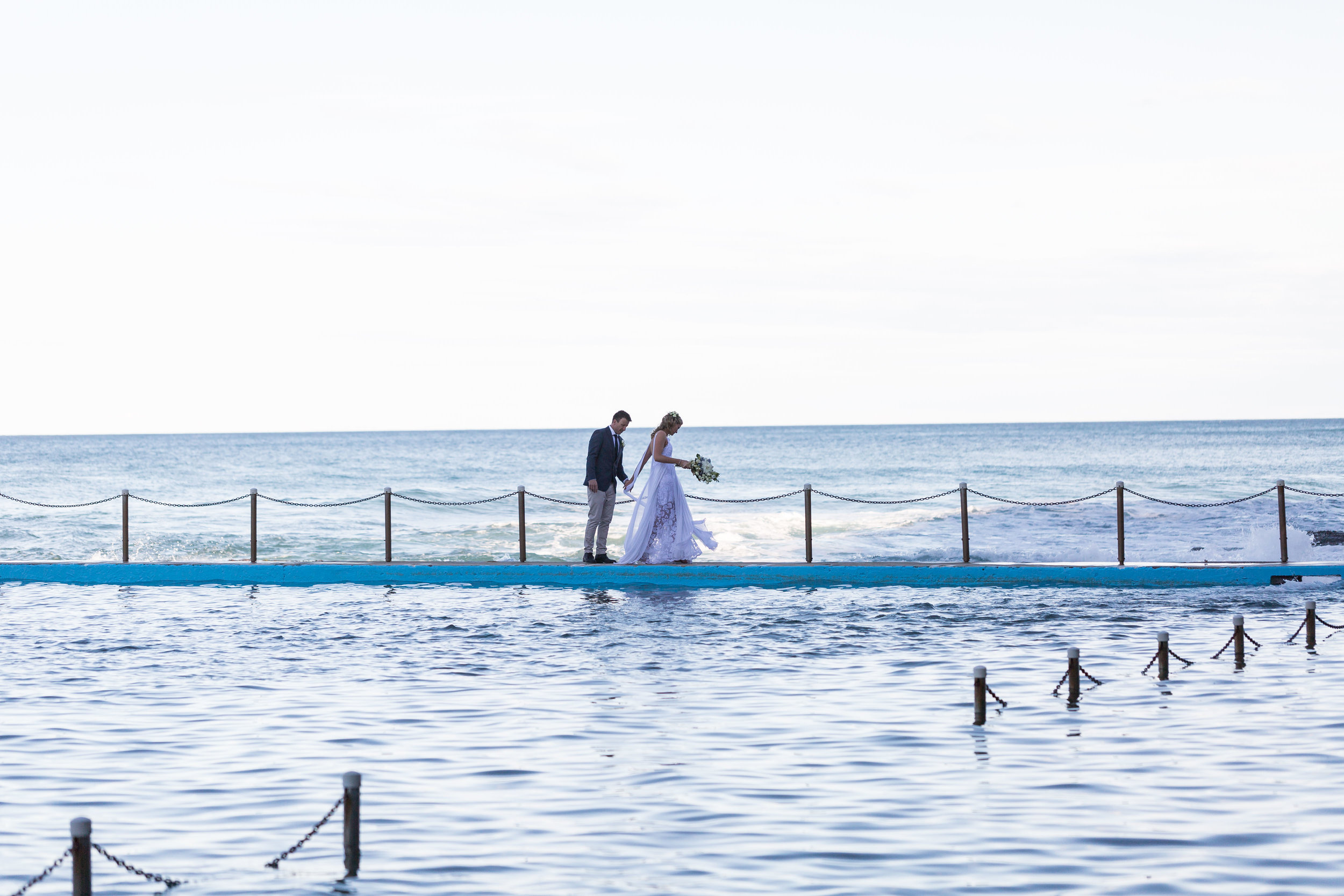 Bride and groom at ocean pool. Bilgola beach wedding