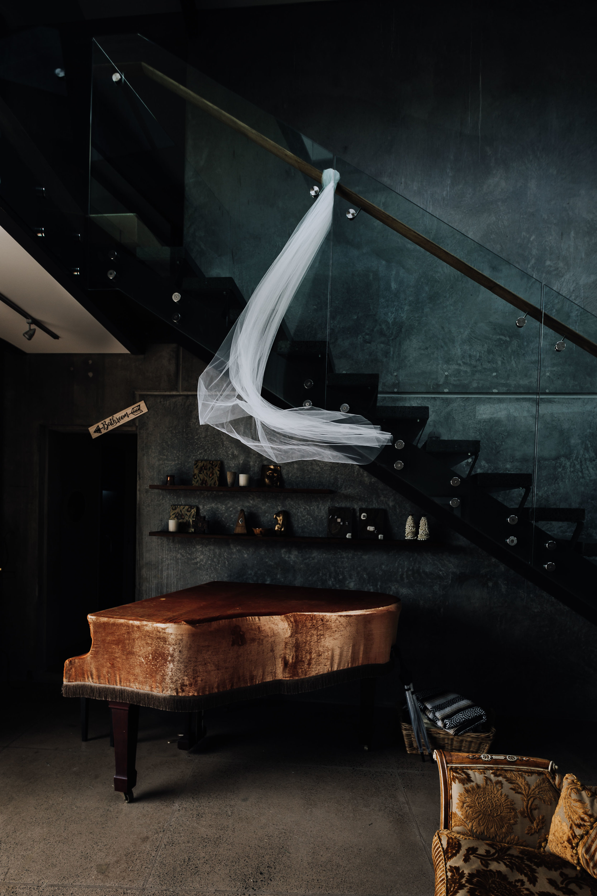 Veil blowing in the wind over a piano. Wedding details. Coromandel Coast Wedding Photography.