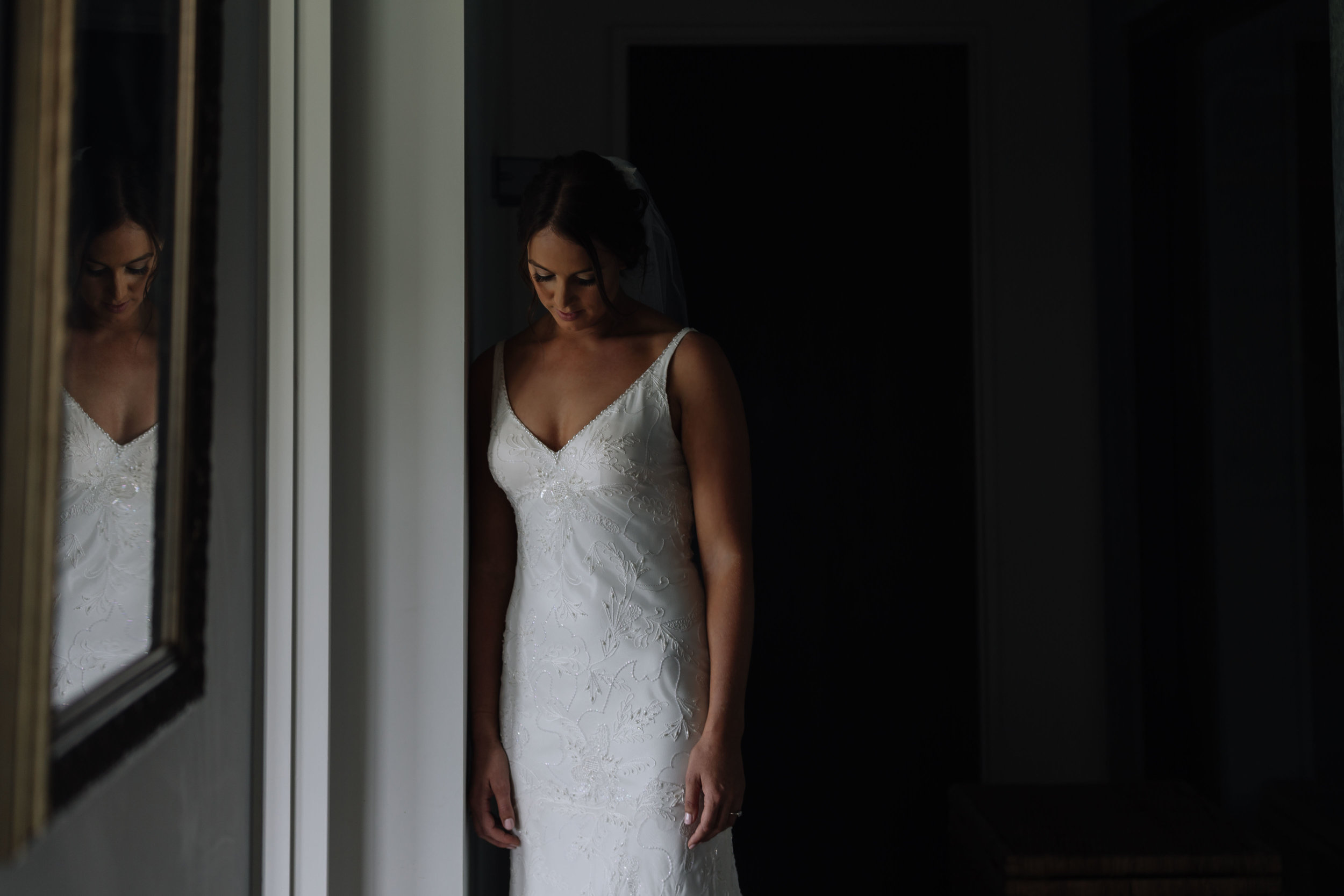 Bride in doorway photo. Natural light, wedding photography. Coromandel coast wedding
