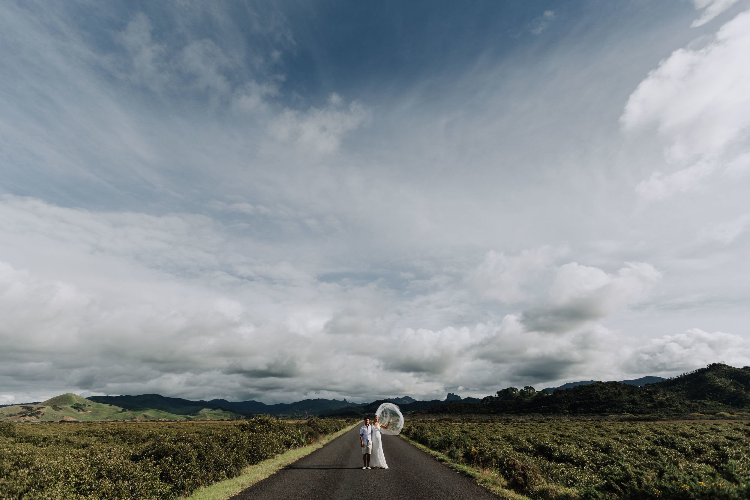 Bride and groom on a country road. Coromandel Coast Wedding.