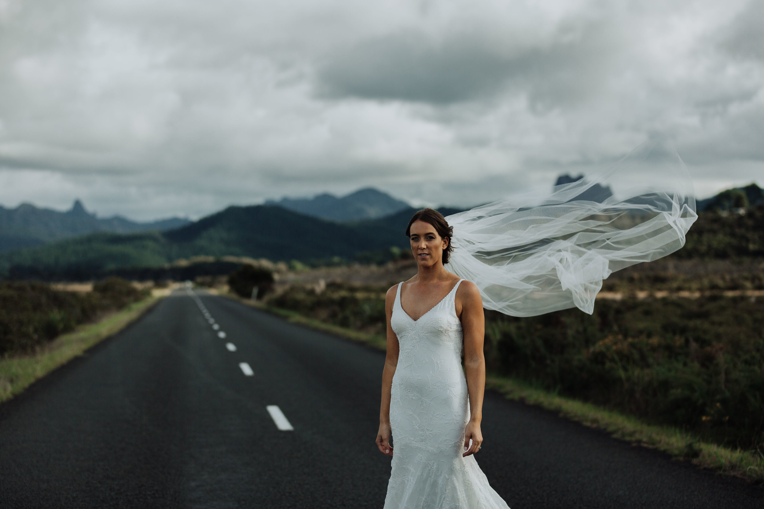 Beautiful bride on a country road. Coromandel Coast New Zealand Wedding.