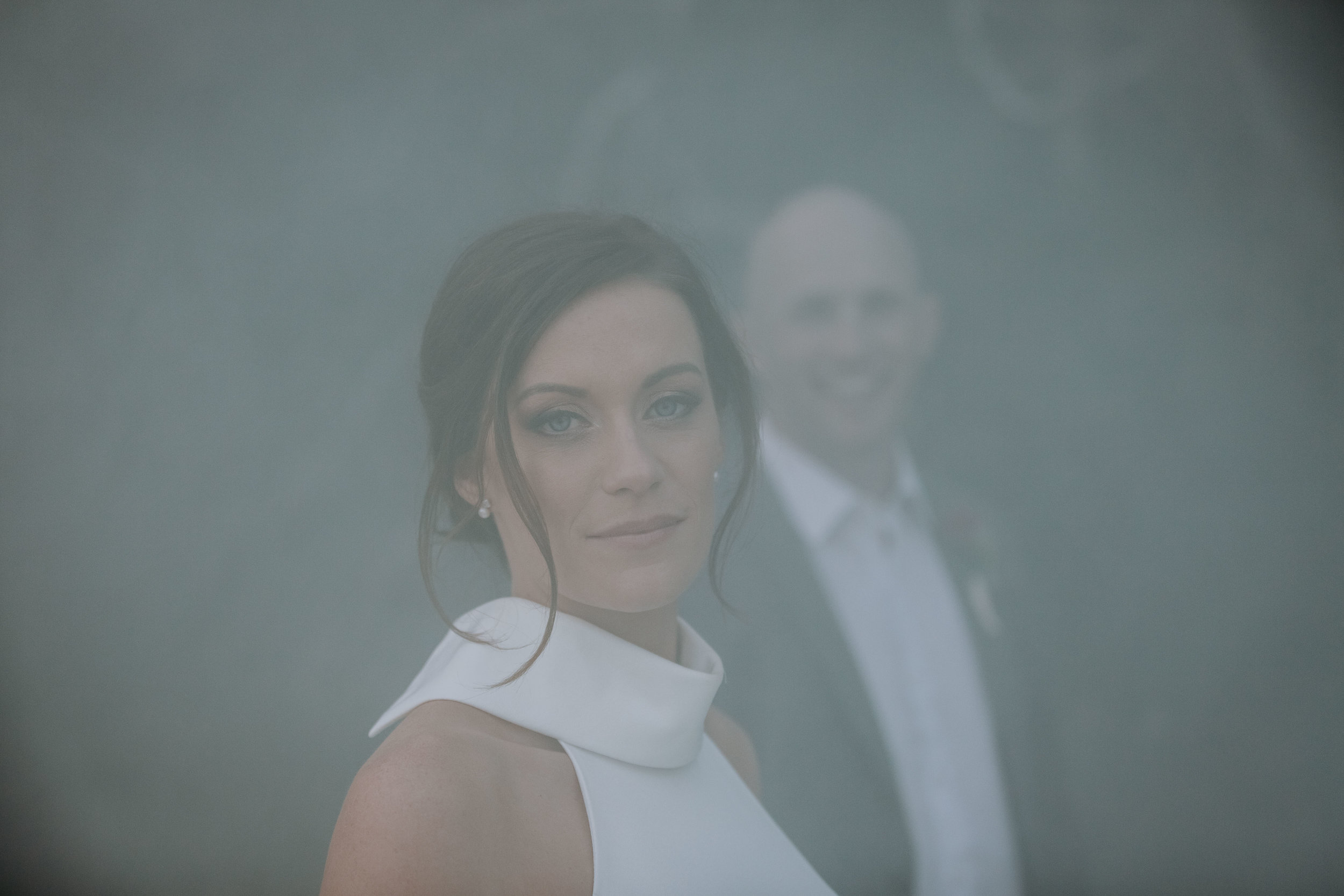 Bride and groom smoke bomb photo. Ripples Chowder Bay wedding.