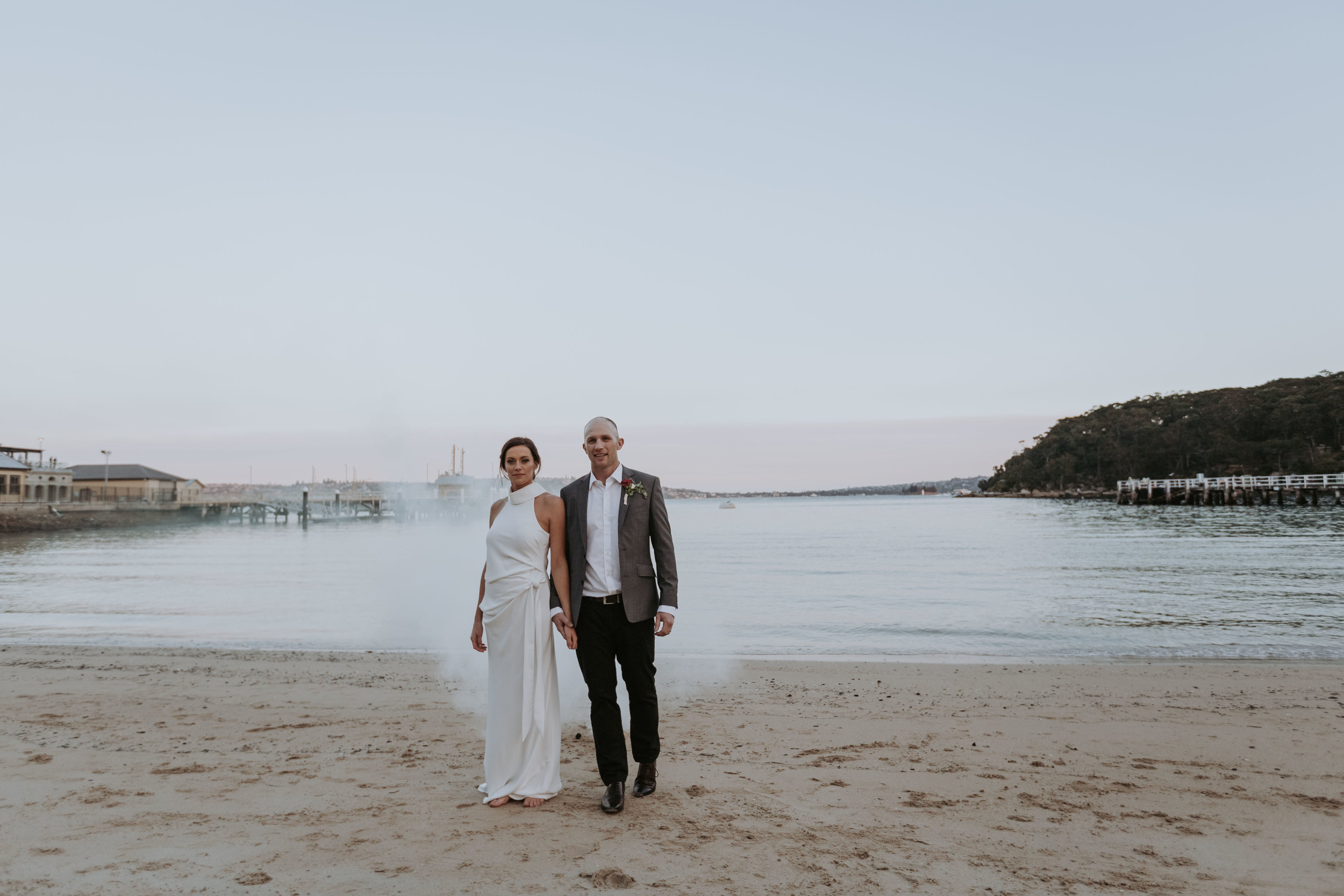Bride and groom at chowder bay. Smoke bomb photo. Ripples Chowder Bay wedding.