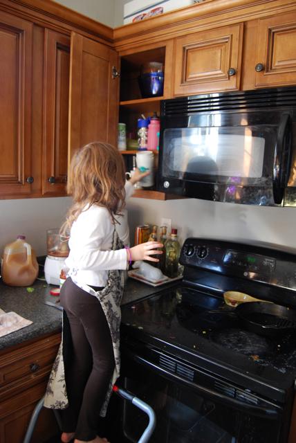 arwen puts dishes away.jpg