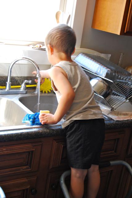 ezra washes dishes.jpg