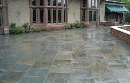 bluestone patio shining in the rain