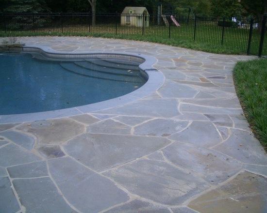 Pool in backyard with bluestone patio