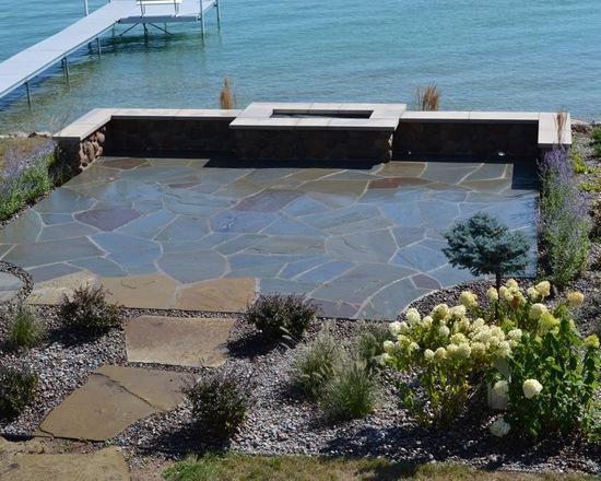lake house backyard with a bluestone patio