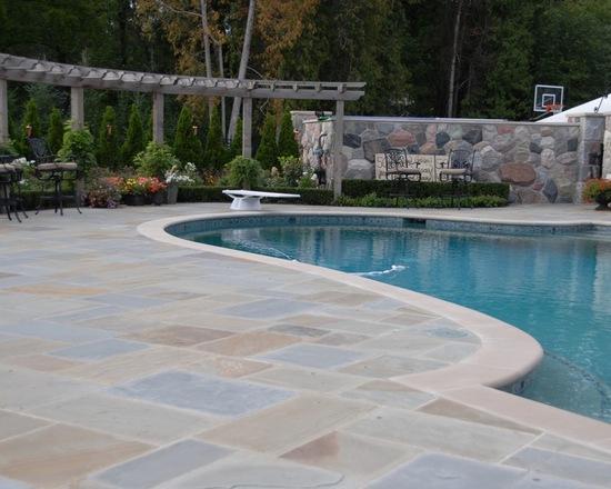 custom stone work pool and terrace