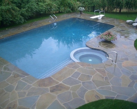 Rectangle pool with built in hot tub and ladders on both sides