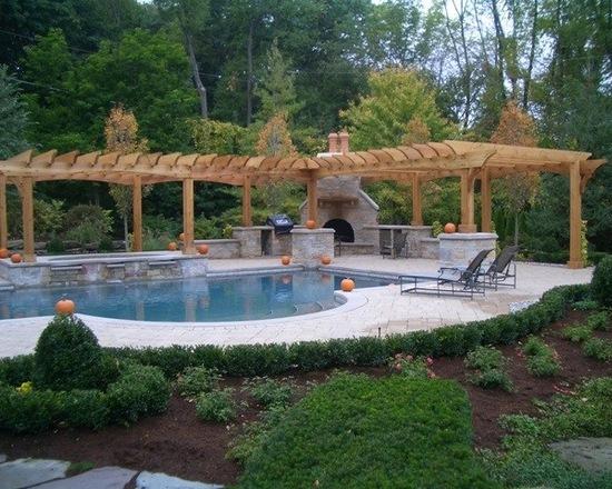 Natural wood pergola with backyard luxury pool and pumpkins