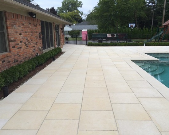 Custom stone patio and pool deck