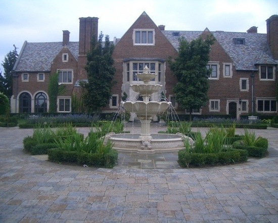 Large brick home with bric driveway