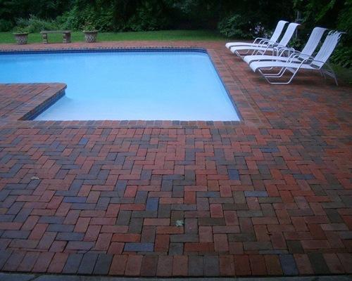 Brick outdoor pool patio