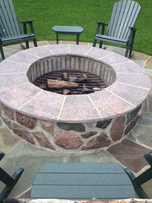 Wooden circle firepit with adirondak chairs