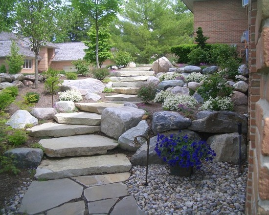 beautiful backyard hardscape with stone steps