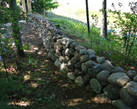 shadows casting on low stone wall in grassy area