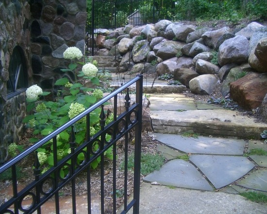 metal rail leading down steps to a nature path in the backyard