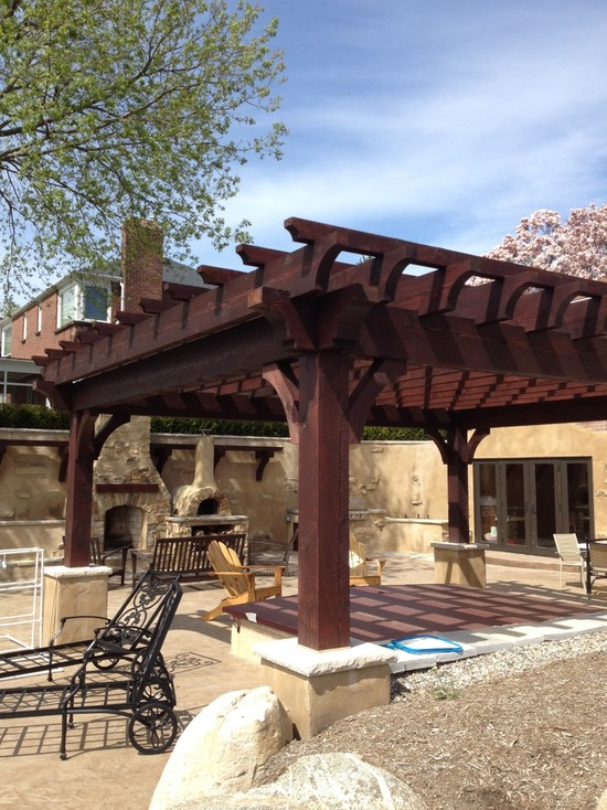 outdoor backyard kitchen covered by wood pergola