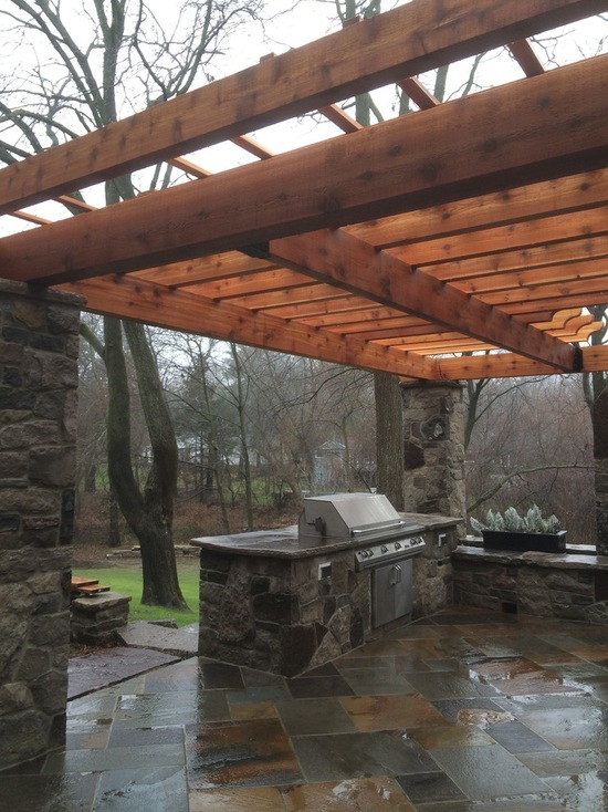 outdoor grill with a pergola on a rainy day