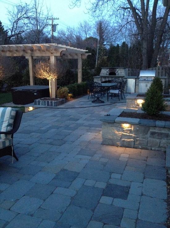 lighted backyard casting shadows on pergola