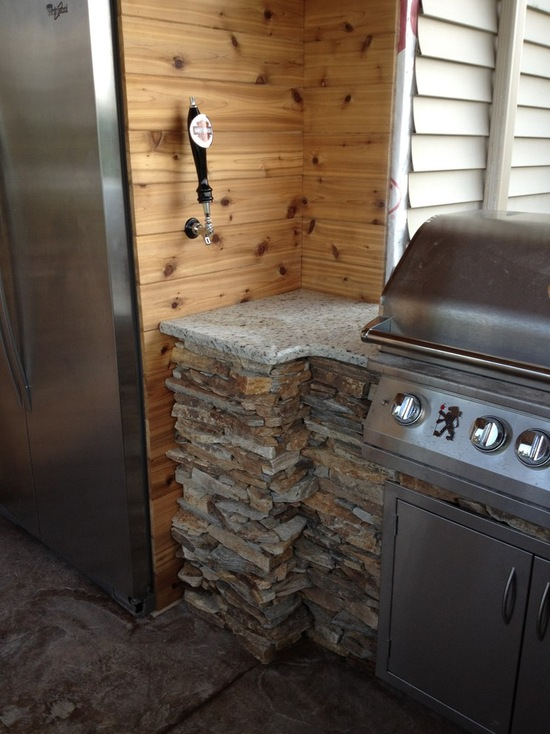 outdoor fridge built into wood frame with stainless steel grill