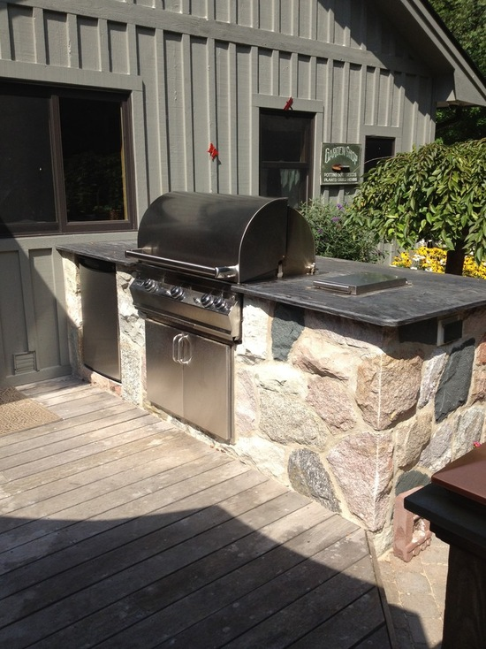natural stone outdoor kitchen with stainless steel appliances