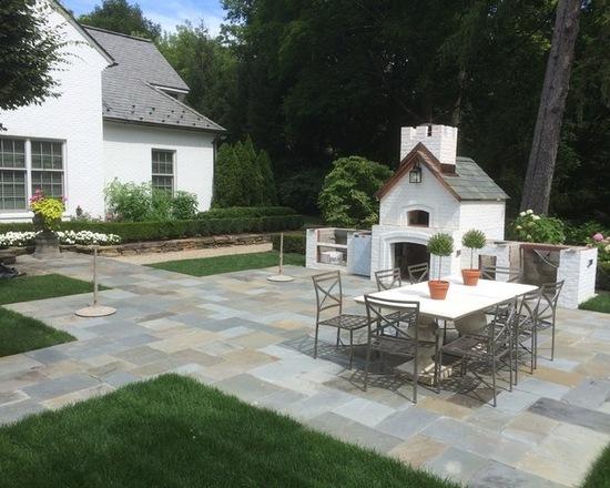 backyard bluestone patio with patio furniture and pizza brick oven