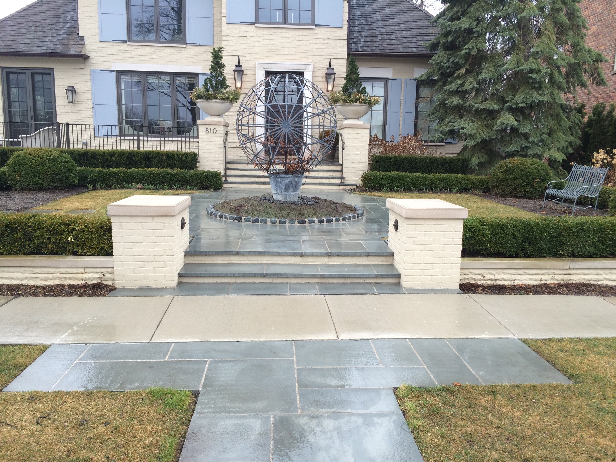 bluestone patio and stairs in front of house