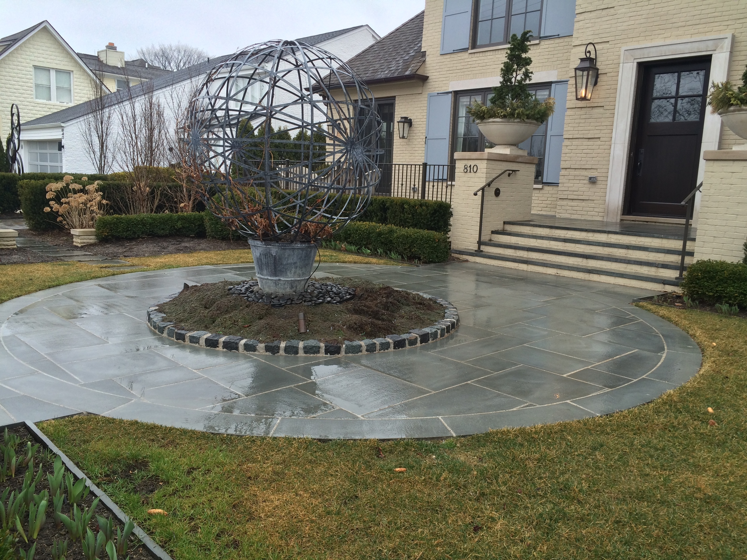circular stone driveway in front of luxury home