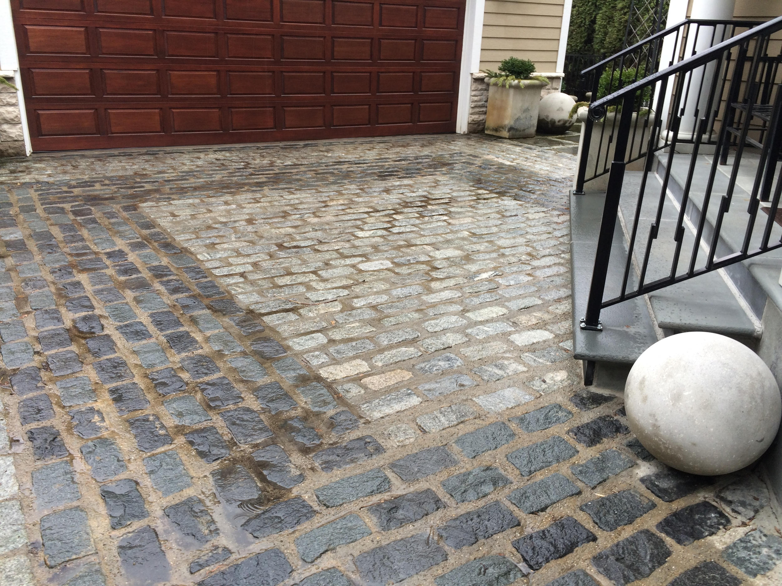 Brick driveway with two shades of brick and rectangle detail