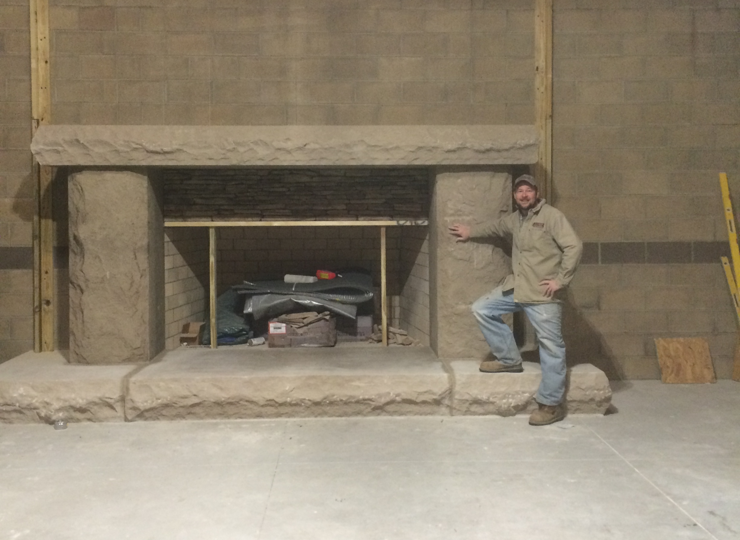 Derek Spurlock with a natural stone fireplace