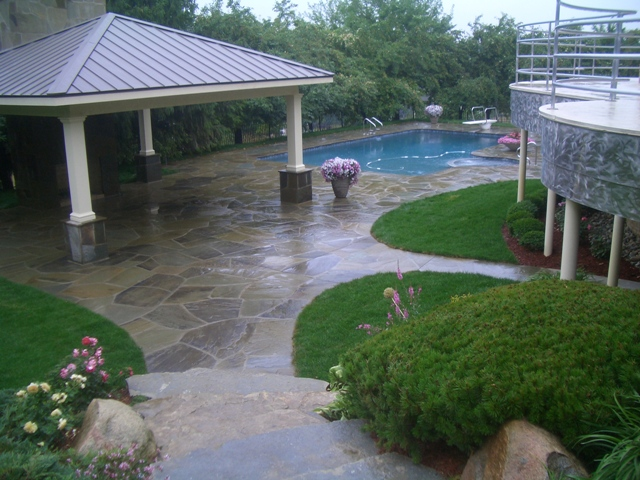 Outdoor covered area next to backyard pool