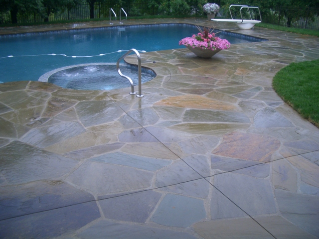 Blue stone natural patio with pool and jacuzzi