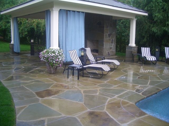 Covered natural stone cabana outdoor space