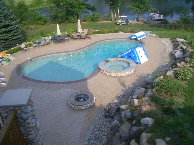 Peanut shaped pool with hot tub