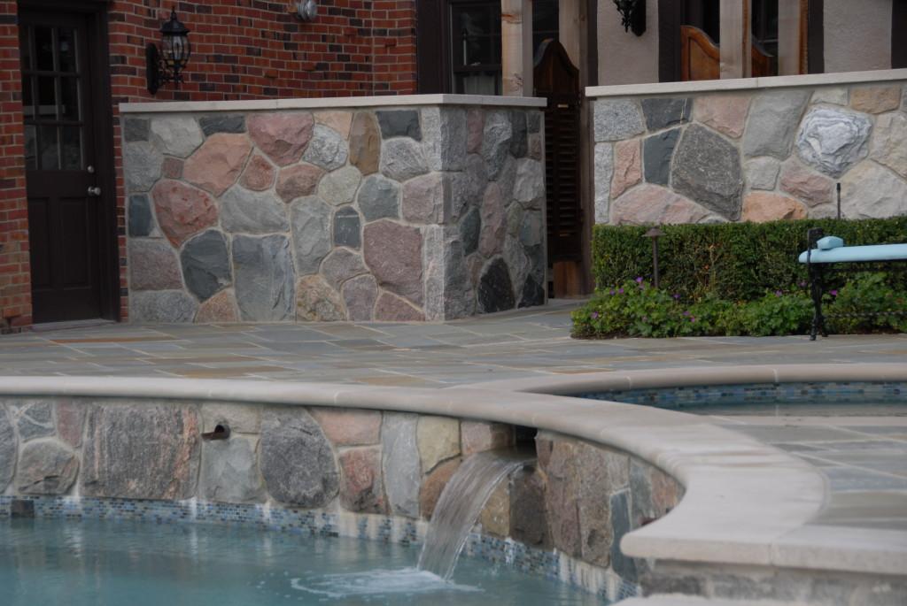 Natural stone wall entrance to the pool
