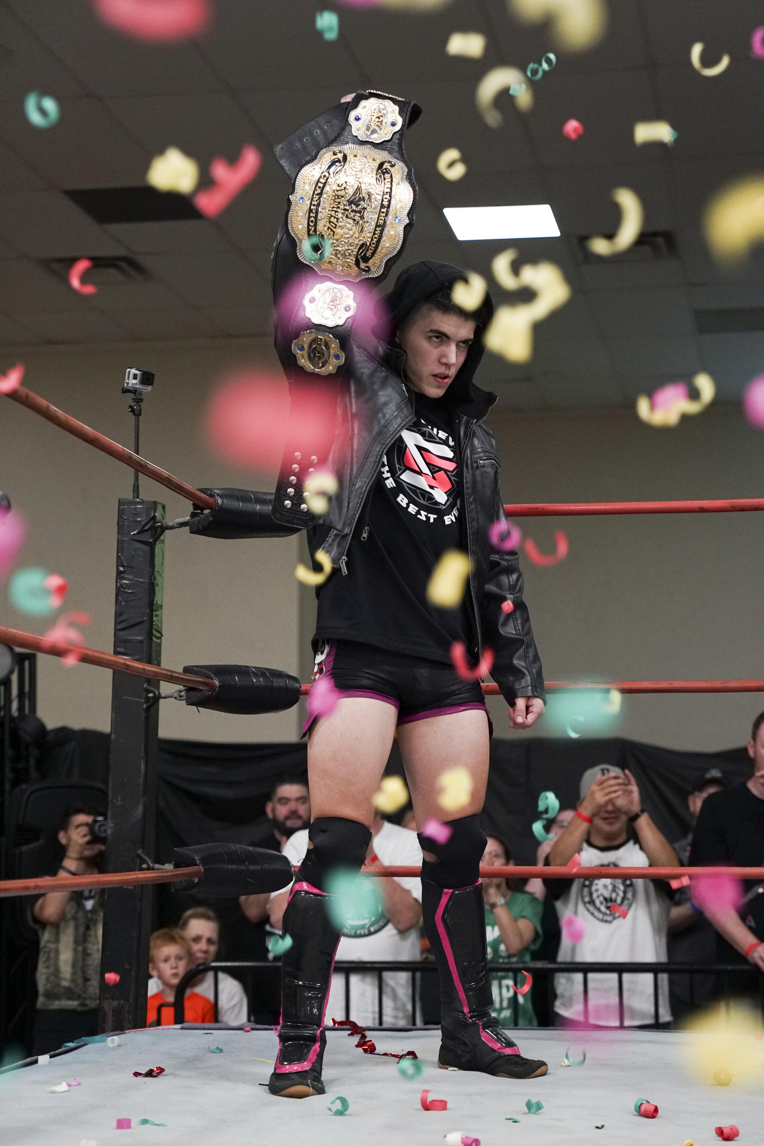VIP Wrestling star Sammy Guevara holding his Championship