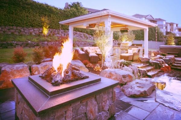 aménagement extérieur laval patio feu pierre.jpeg