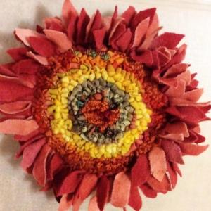 hooked prodded sunflower pin.jpg