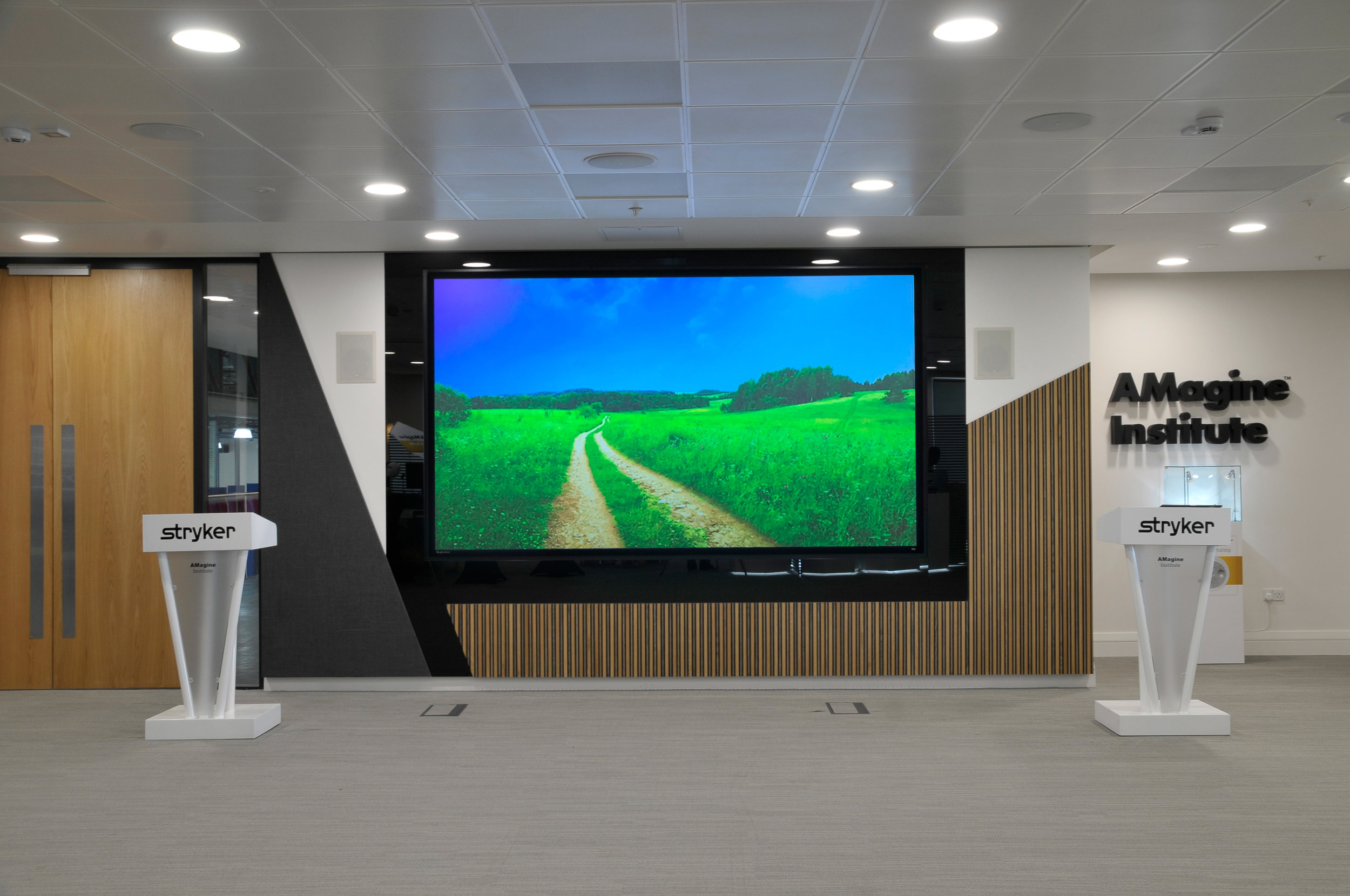 "139"" Infinity in brightly lit presentation room"