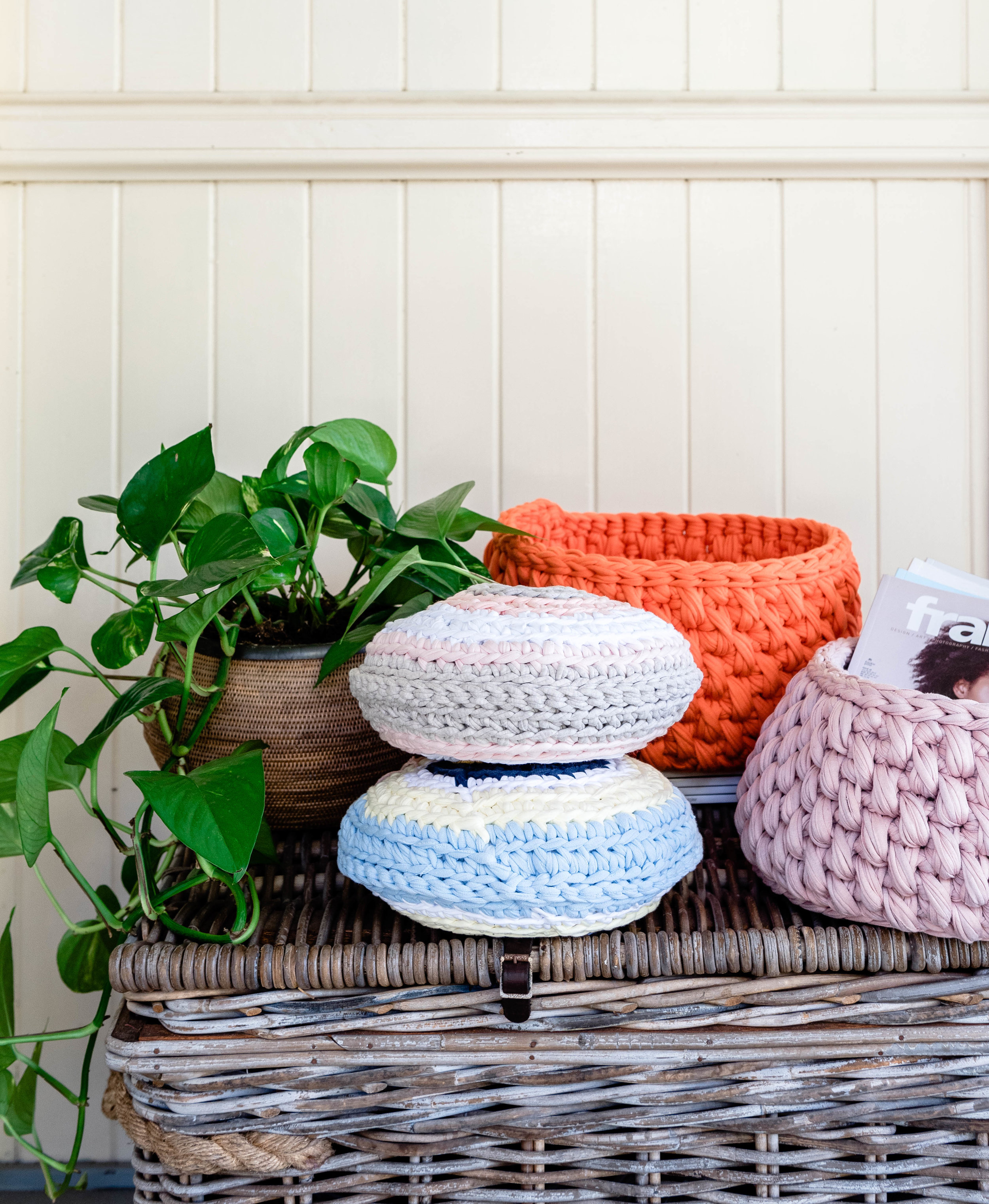 Hand crocheted cushions and baskets made in Germany by Lumikello out of recycled materials