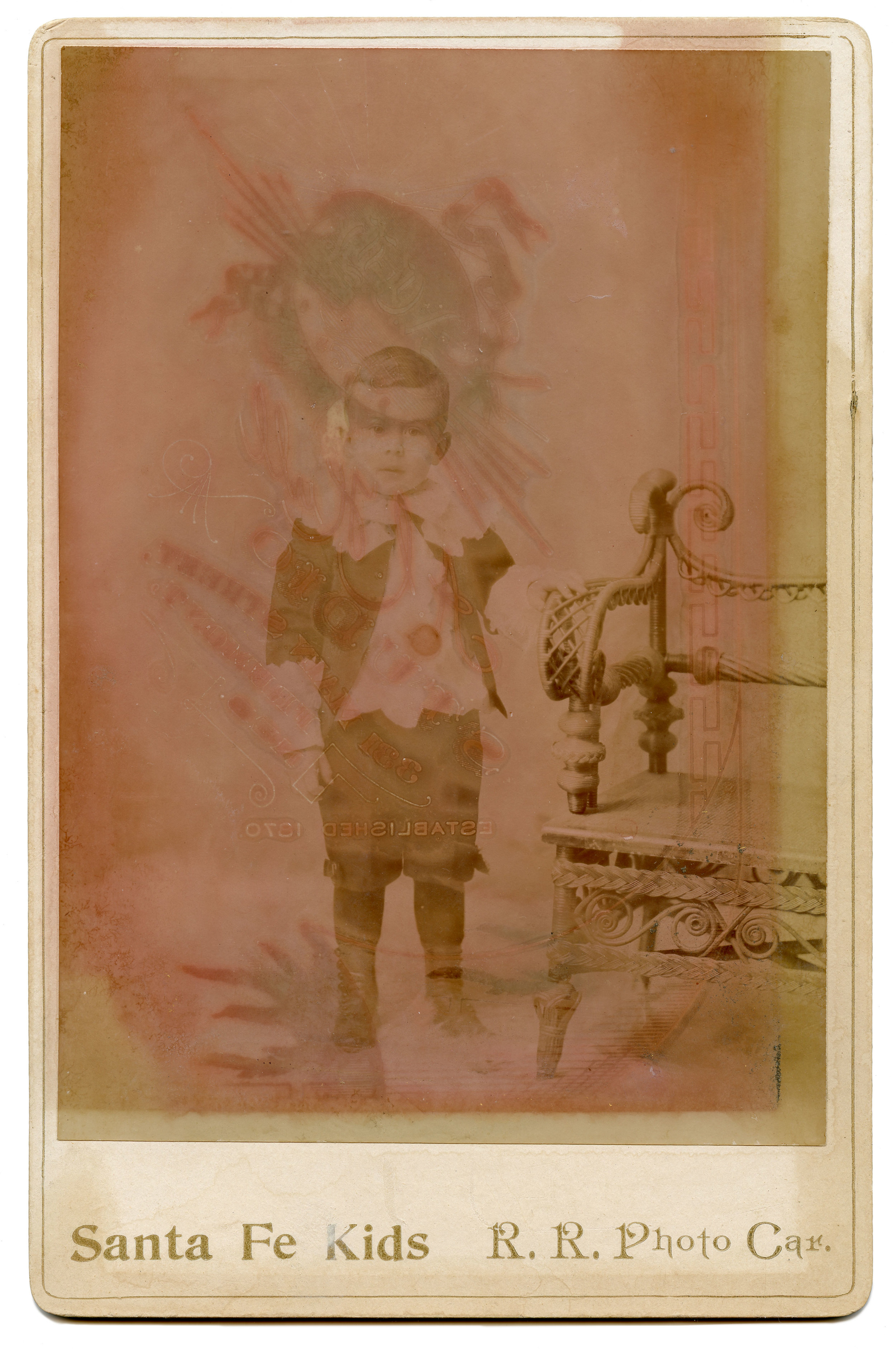 """""""Sante Fe Kids -- R.R. Photo Car"""" Victorian cabinet card, Late 19th c,  6.5"""" x 4.25"""" Found in Wilkes-Barre, PA   I acquired this card because of the watermark-like stain left on the photograph from what may have been another photo made by Arundel Hull of Fremont, Nebraska during the late 19th century.  A.C. Hull  was assistant to  William Henry Jackson  in his extenstive documentation of the early west, more specifically, the expansion of the Union Pacific railroad. With a blank back, it's hard to tell if this was in fact taken by A.C. Hull but the markings suggest it was in the company of his work at some point. An error in the making perhaps? In any case, I love the flaws, I love the colors."""