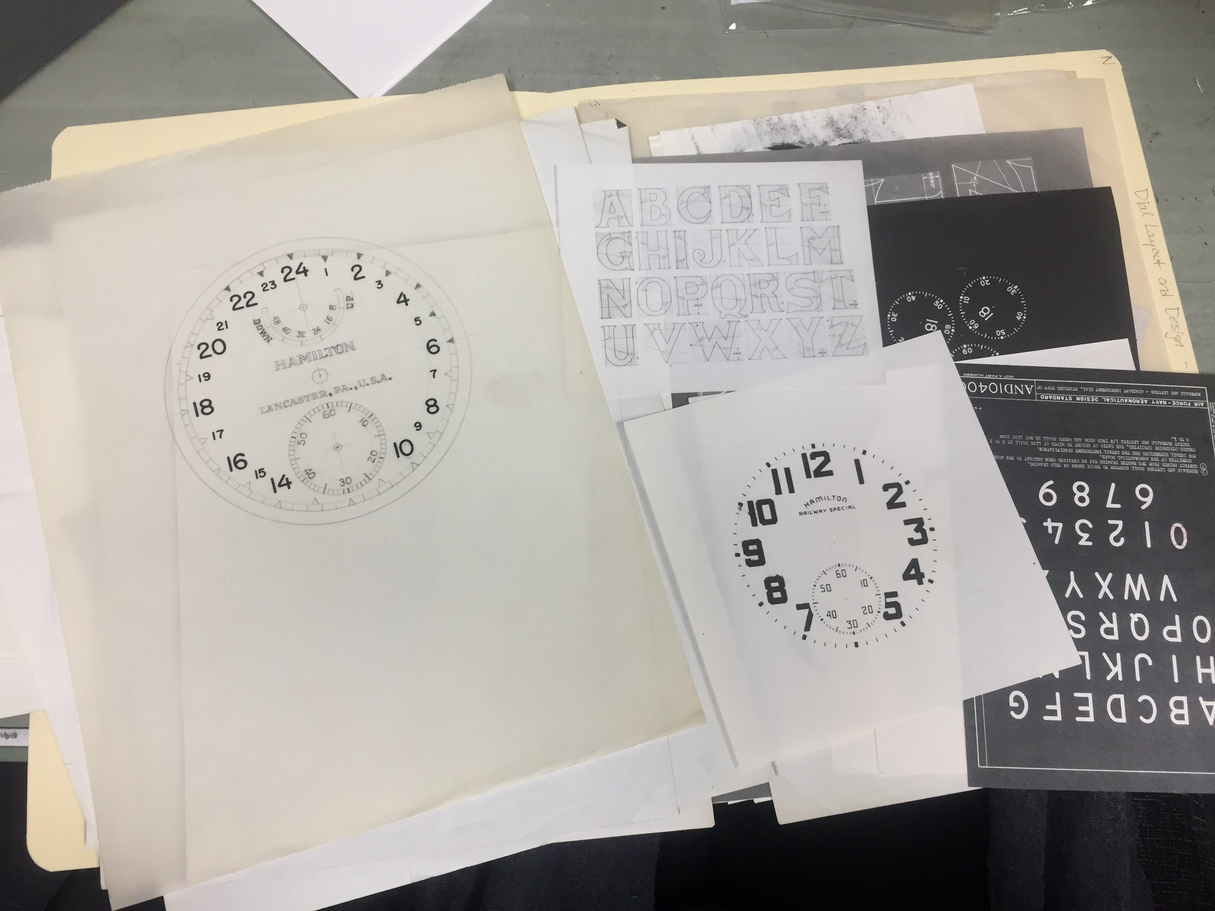 A folder of dial design materials from Carl Yecker's files.