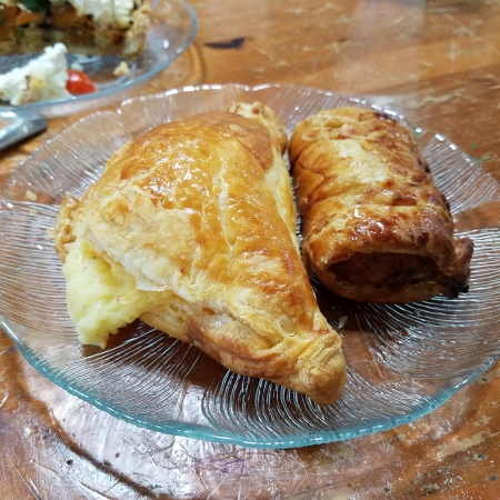A Cheese Pasty (left) and a Sausage Roll—the magic is inside.